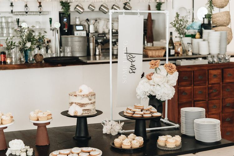 Dessert Table with Individual Cakes and Something Sweet Contemporary Wedding Sign  on Metal Frame