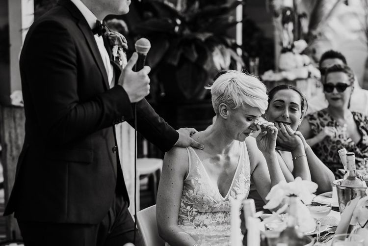 Emotional Bride with Short Hair in Made With Love Wedding Dress Listening to Her Grooms Wedding Speech
