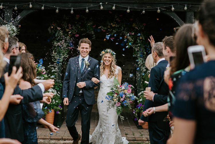 Confetti Exit with Bride in Lace Watters Wedding Dress and Groom in Navy Hugo Boss Suit