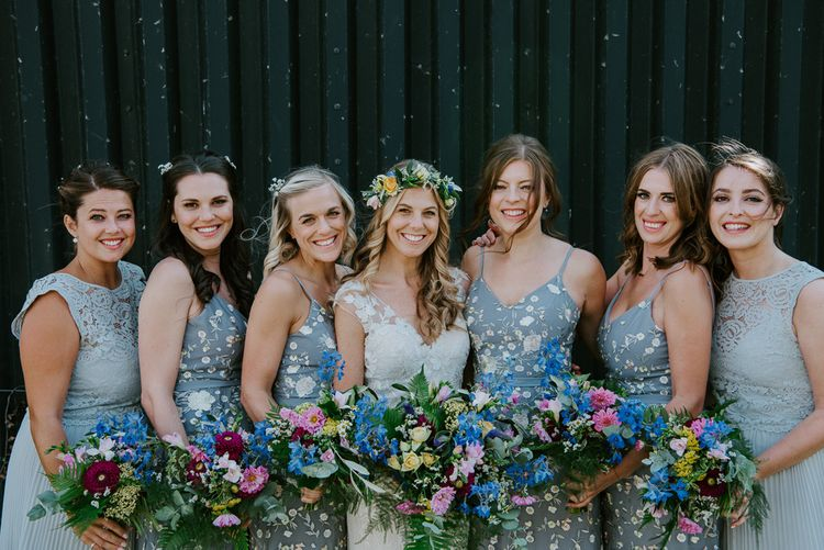 Bridal Party Portrait with Bridesmaids in Blue Floral and Blue Lace Oasis and ASOS Dresses and Bride in Lace Watters Wedding Dress with Flower Crown