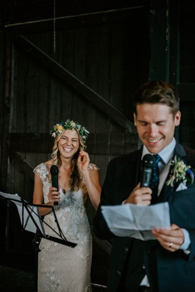 Bride and Groom Laughing During a Joint Wedding Speech