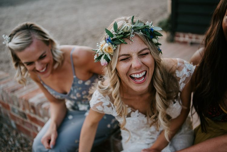 Freckly Bride with Curly Hair and Flower Crown Laughing with her Girlfriends