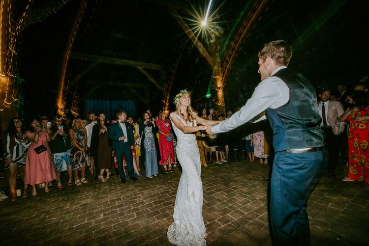 First Dance with Bride in Lace Watters Wedding Dress and Flower Crown and Groom in Navy Hugo Boss Suit