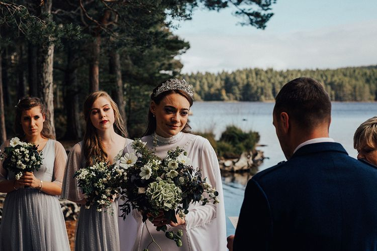 Outdoor Wedding Ceremony at Loch Garten with Bride in High neck Vintage Wedding Dress and Bridesmaids in Gowns from BHLDN