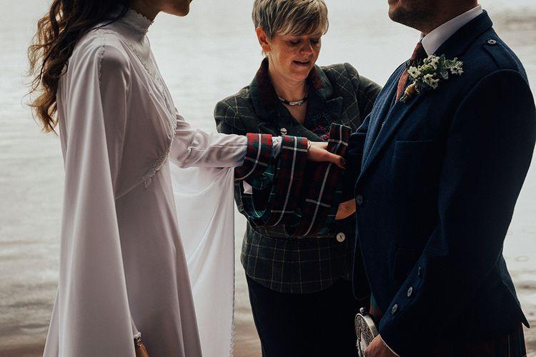 Outdoor Wedding Ceremony at Loch Garten in Scotland with hand Fastening Ceremony