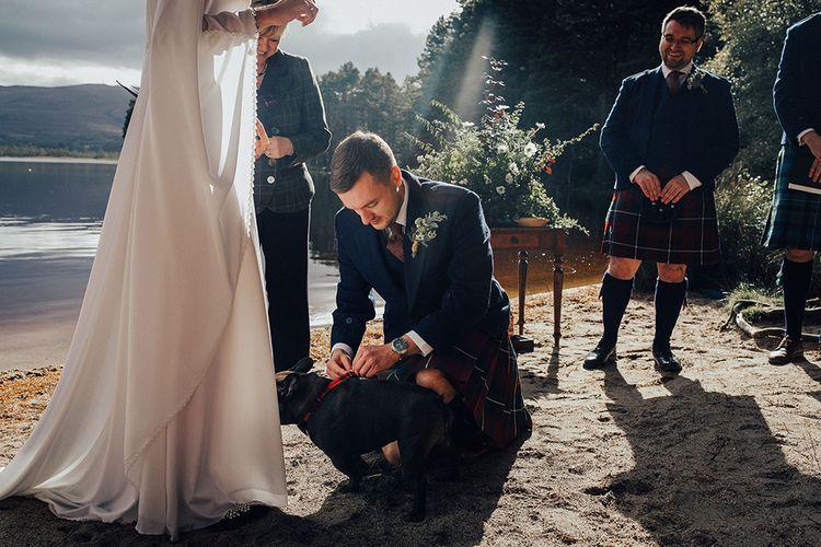 Pug Ring Bearer at Outdoor Wedding Ceremony at Loch Garten in Scotland