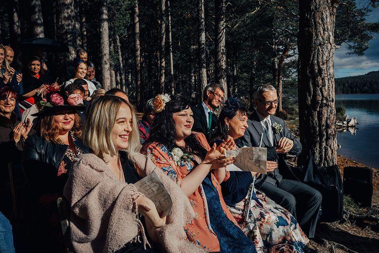 Wedding Guests Clapping at Outdoor Wedding Ceremony at Loch Garten in Scotland