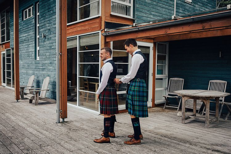 Groomsmen on The Wedding Morning Getting Dresses into Traditional Highland Wear