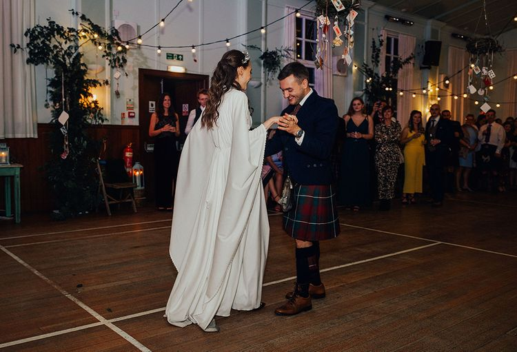 First Dance with Bride in Vintage Wedding Dress with Bell Sleeves and Groom  in Tartan Kilt
