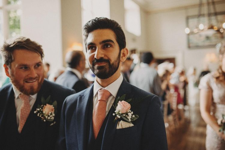Groom In Pink Tie Waits At Altar For Bride