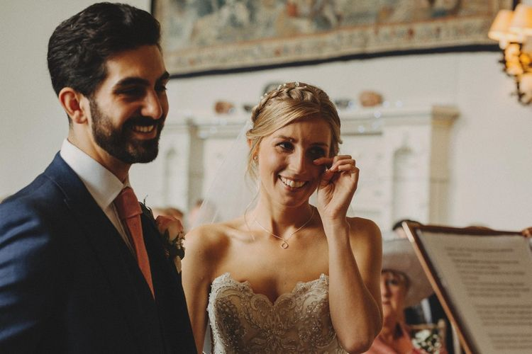 Bride Wipes Away Happy Tears During Ceremony