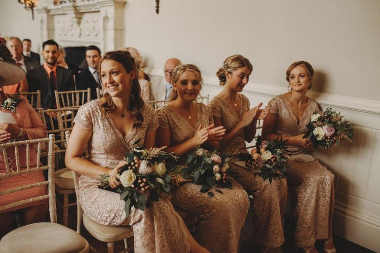 Bridesmaids During Ceremony In Pink Dresses