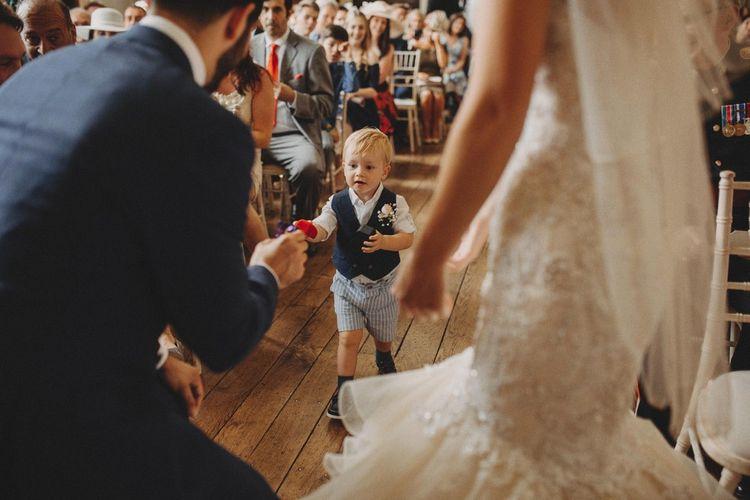 Kids At Weddings Page Boy Brings Rings with Bride In Mermaid Wedding Dress