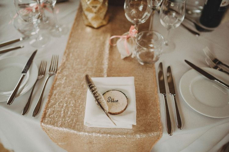 Wedding Place Setting With Tree Slice Name Place and Feather Decor