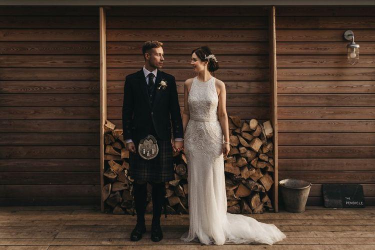 Groom wears traditional Scottish kilt for wedding