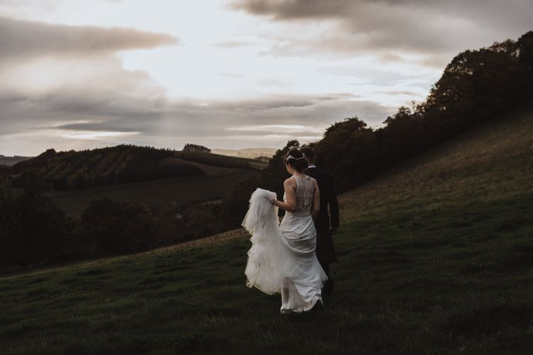 Bride and groom take a walk over Guardswell Farm fields