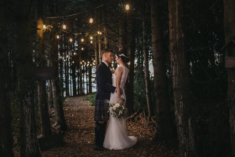 Woodland portrait of bride and groom