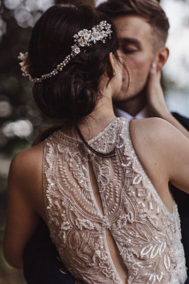 Lace back wedding dress with embellished hairpiece for bride