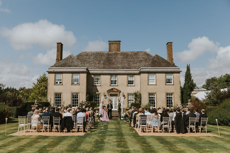 Blush Pink Wedding Dress For Outdoor Wedding Ceremony At Hethfelton House With Images From Dorset Wedding Photographer Paul Underhill