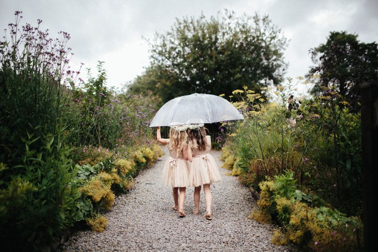 Flower Girls In Pastel Dresses // Nancarrow Farm Cornwall Wedding With Hanging Foliage Decor & Pastel Bridesmaids Dresses With Images From Ben Selway Photography