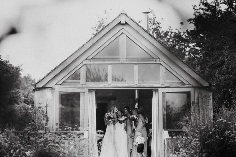 Bride Getting Ready At Nancarrow Farm // Nancarrow Farm Cornwall Wedding With Hanging Foliage Decor & Pastel Bridesmaids Dresses With Images From Ben Selway Photography