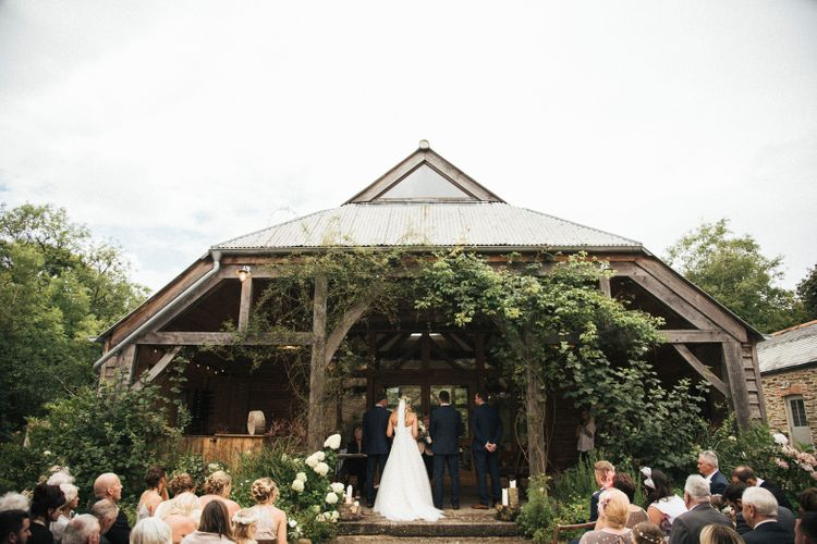 Outdoor Wedding Ceremony // Nancarrow Farm Cornwall Wedding With Hanging Foliage Decor & Pastel Bridesmaids Dresses With Images From Ben Selway Photography
