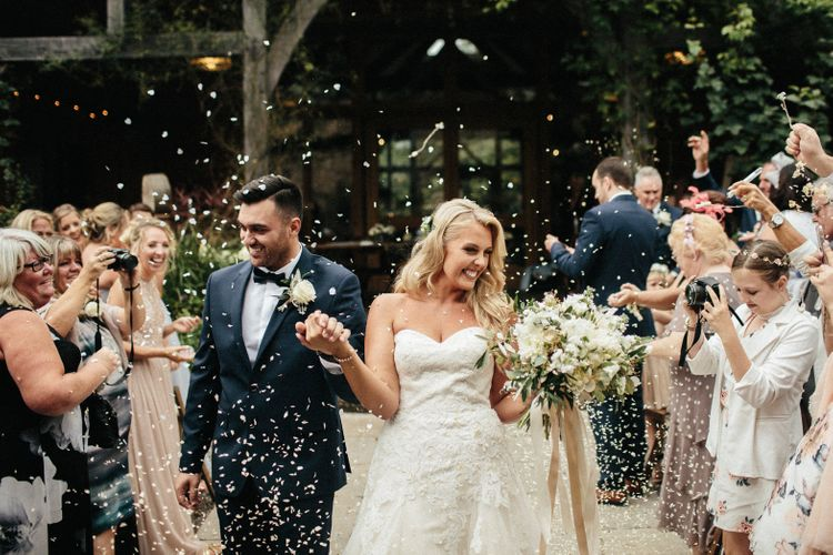 Confetti Shot // Nancarrow Farm Cornwall Wedding With Hanging Foliage Decor & Pastel Bridesmaids Dresses With Images From Ben Selway Photography