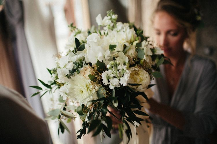 White Wedding Bouquet With Foliage // Nancarrow Farm Cornwall Wedding With Hanging Foliage Decor & Pastel Bridesmaids Dresses With Images From Ben Selway Photography