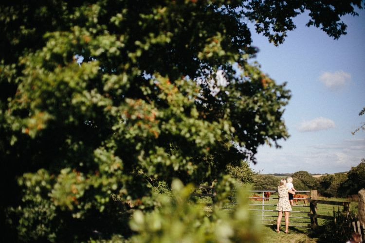 Nancarrow Farm Cornwall Wedding With Hanging Foliage Decor & Pastel Bridesmaids Dresses With Images From Ben Selway Photography