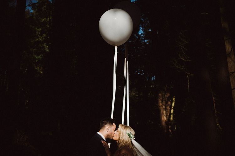 Couple Shots With Giant Balloons // Nancarrow Farm Cornwall Wedding With Hanging Foliage Decor & Pastel Bridesmaids Dresses With Images From Ben Selway Photography
