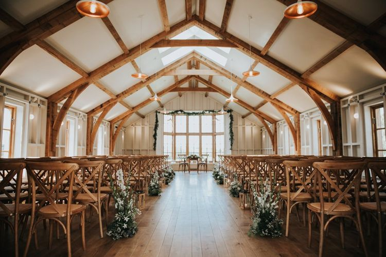 Rustic barn wedding ceremony at Hyde House