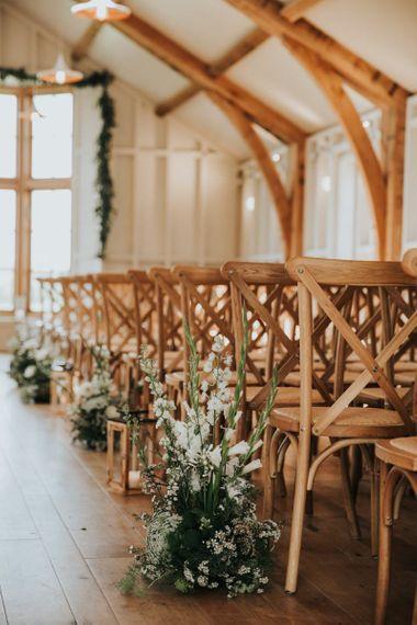 Aisle flower decor at rustic barn wedding at Hyde House