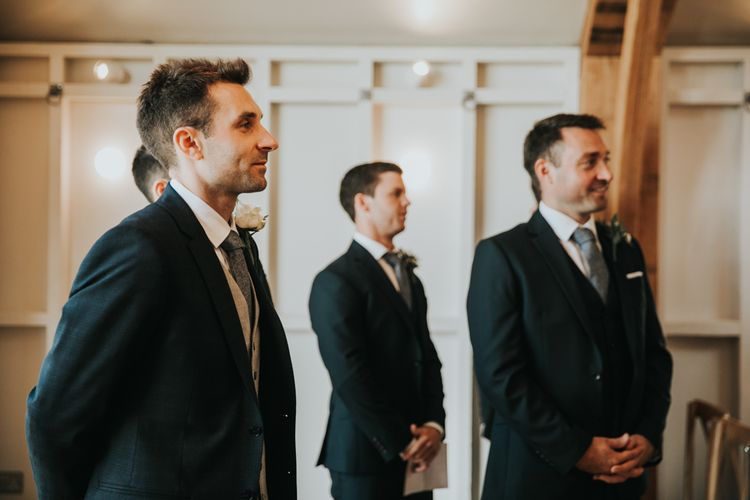Groom with groomsmen waiting for bride at Hyde House wedding