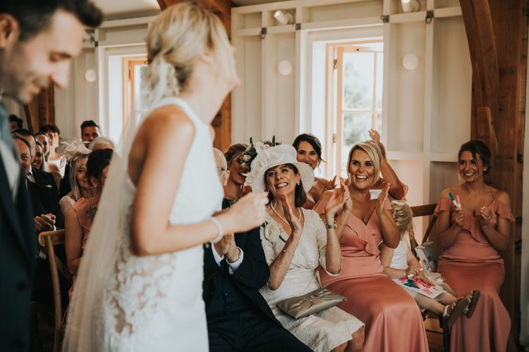Bridesmaids cheer during wedding ceremony