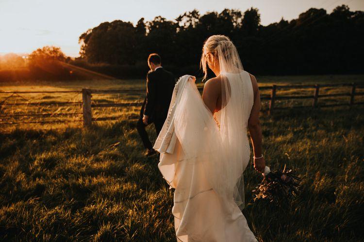 Bridal updo with veil and Justin Alexander wedding dress