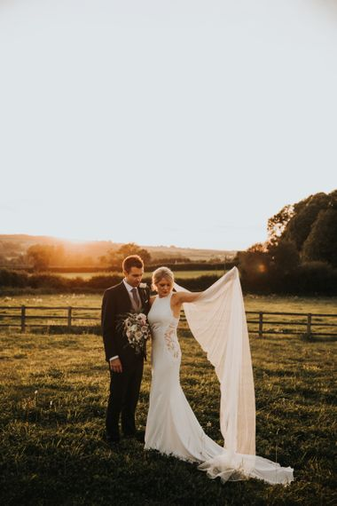 Bride in lace panel wedding dress