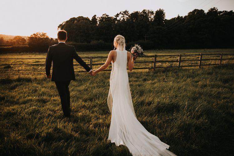 Justin Alexander wedding dress with undo and blush bouquet