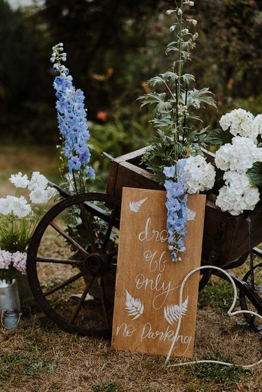 Rustic Planter Pot Filled with White and Blue Flowers