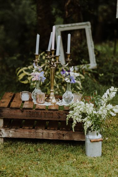 Wooden Pallets Decorated with Miniature Milk Churns, and Brass Candelabra