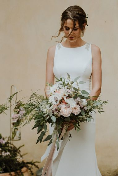 Bride in Fitted Mikaella Bridal Wedding Dress Holding Her Bouquet