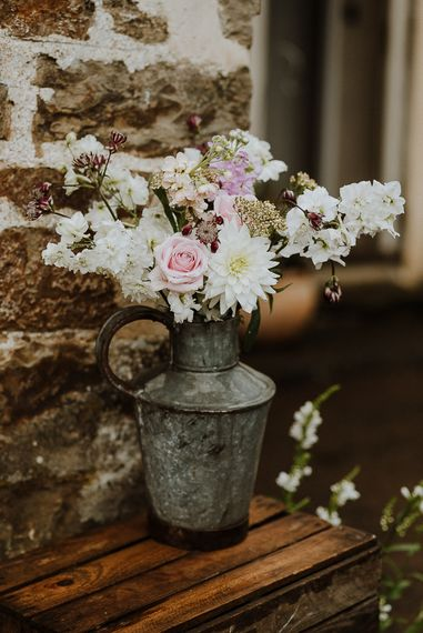 Metal Jug Filled with Wild Wedding Flowers