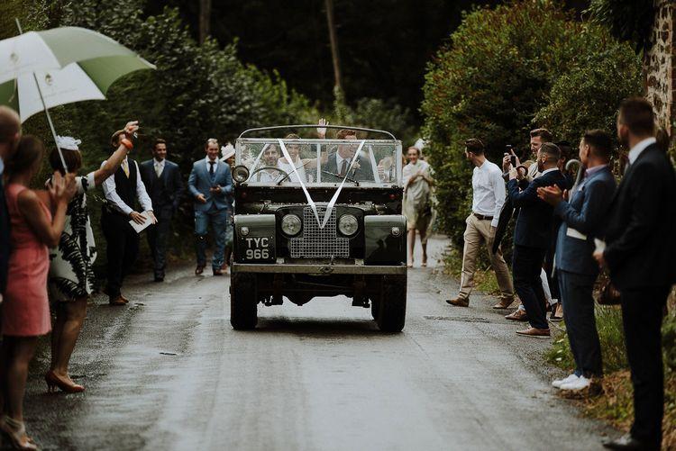 Bride and Groom in Land Rover Wedding Car