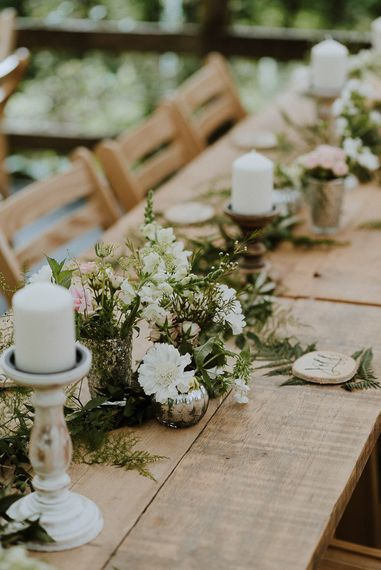 Wooden Table with Flower Table Centrepiece and Candles