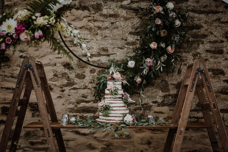 Semi Naked Wedding Cake on Rustic Ladder Table Top with Flower Hoop Backdrop