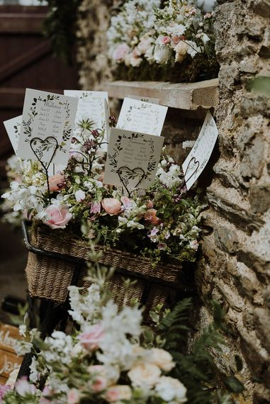 Vintage Bicycle Basket Filled with Flowers as a Wedding Table Plan