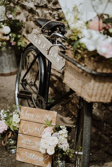 Wooden Table Plan Sign Tied to Vintage Bicycle