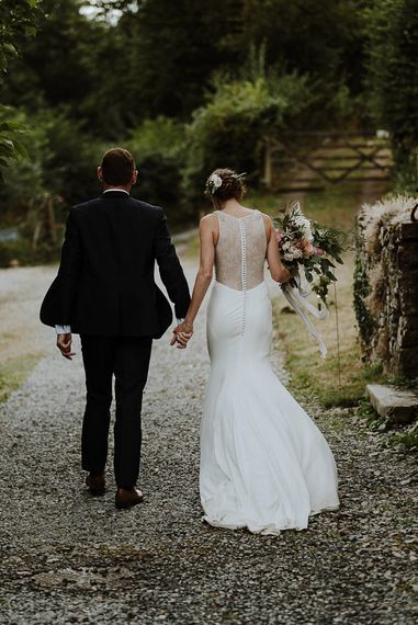 Bride in Lace Back Mikaella Bridal Fitted Wedding Dress and Groom in  Clifton Suit