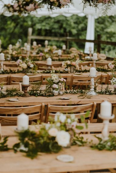 Wooden Tables with Candles and Flower Decor