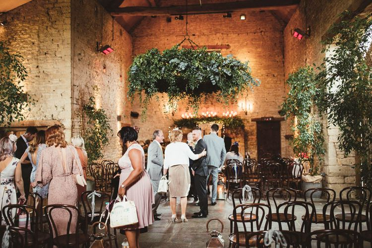 Cripps Barn Wedding Venue with Greenery Chandelier and Arrangements