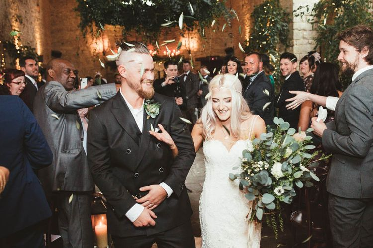 Bride  in Danni Made With Love Bridal  Wedding Dress and Groom in Reiss Suit Walking Up The Aisle